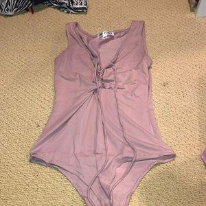 blush lace up body suit